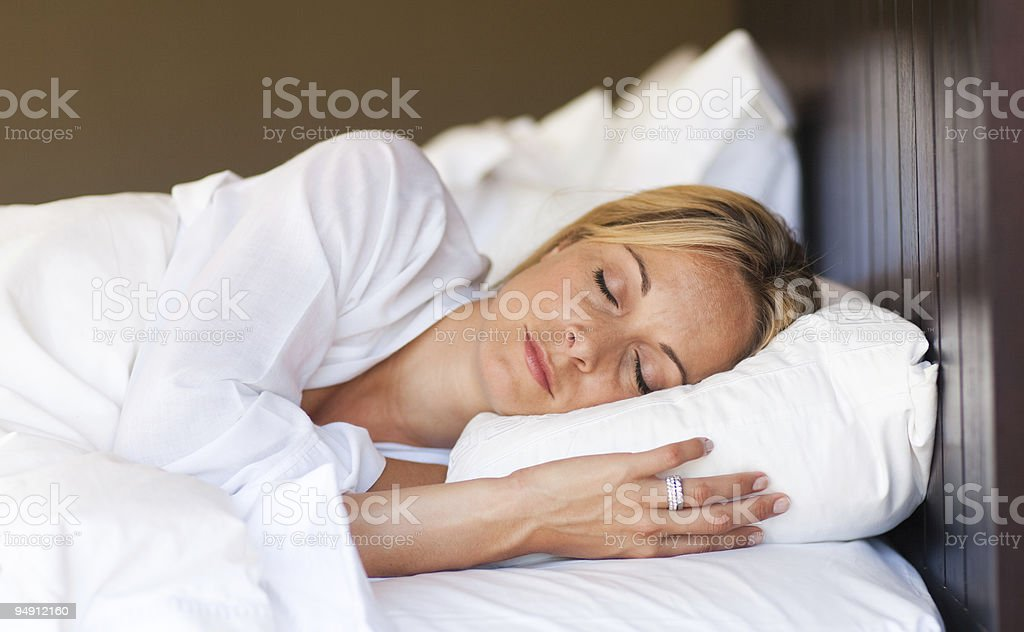 Young woman relaxing in bed royalty-free stock photo