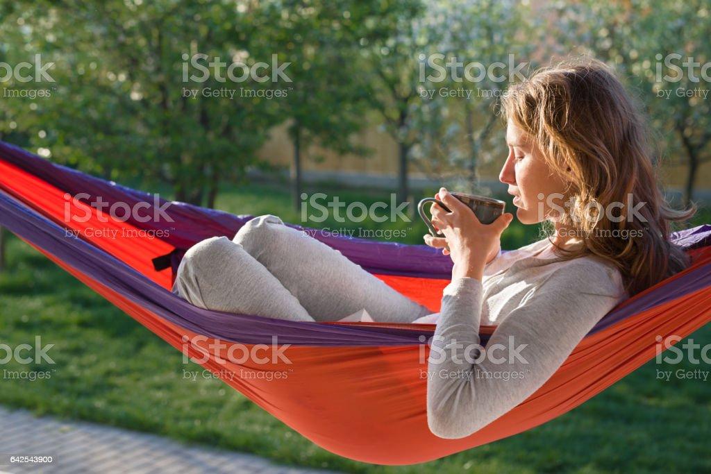 Young woman relaxing in hammok stock photo