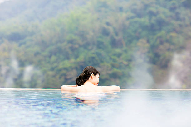 young woman relaxing in  hot springs - hot spring stock photos and pictures