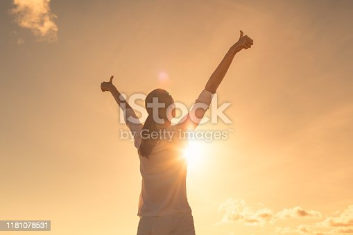 952953174 istock photo Young woman relaxing in summer sunset sky outdoor. 1181078531