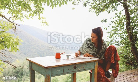 istock Young woman relaxing in the beautiful nature 579418598