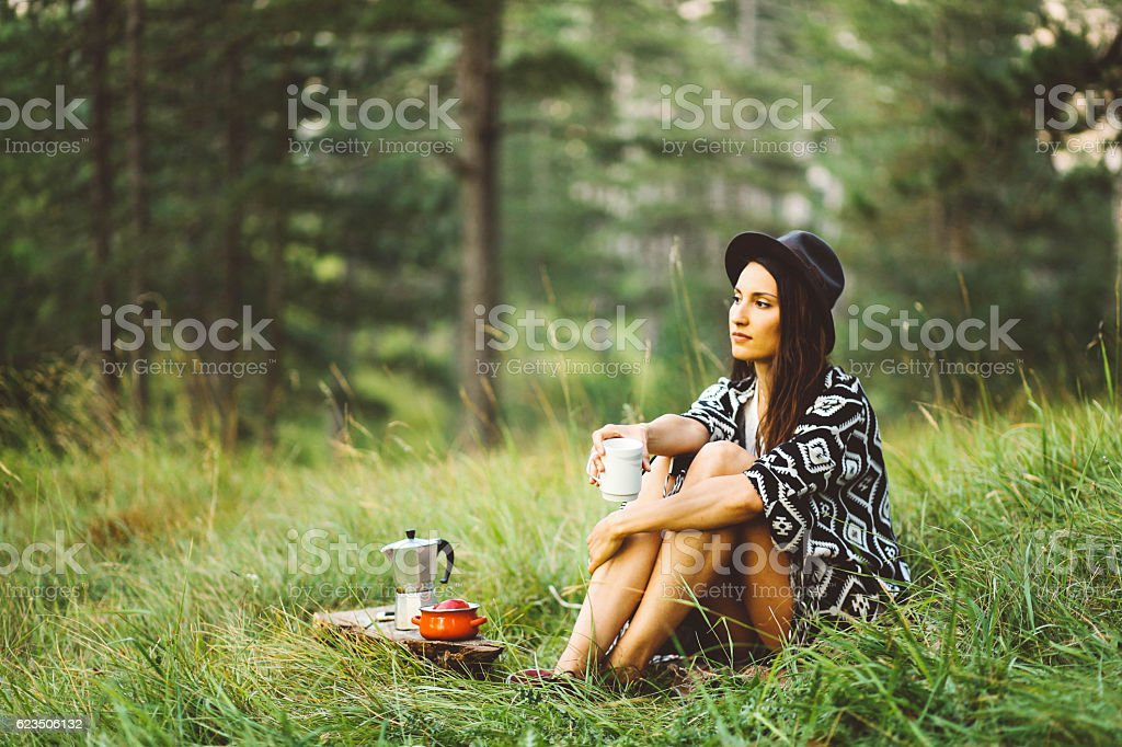 Young woman relaxing in the forest stock photo