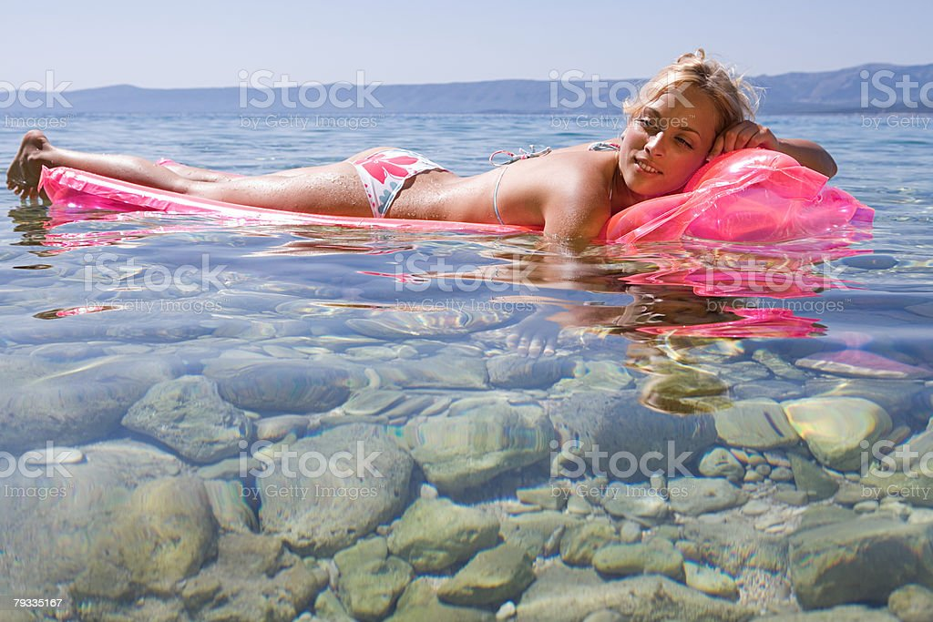 Young woman relaxing in the sea 免版稅 stock photo
