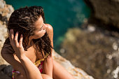 istock Young woman relaxing on a beautiful beach 1178585430