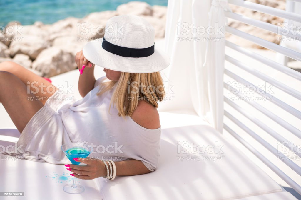 Young woman relaxing on a sunbed - foto de acervo