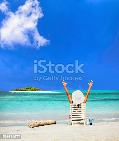 476618818 istock photo Young woman relaxing on chair in a Caribean island beach 538614977