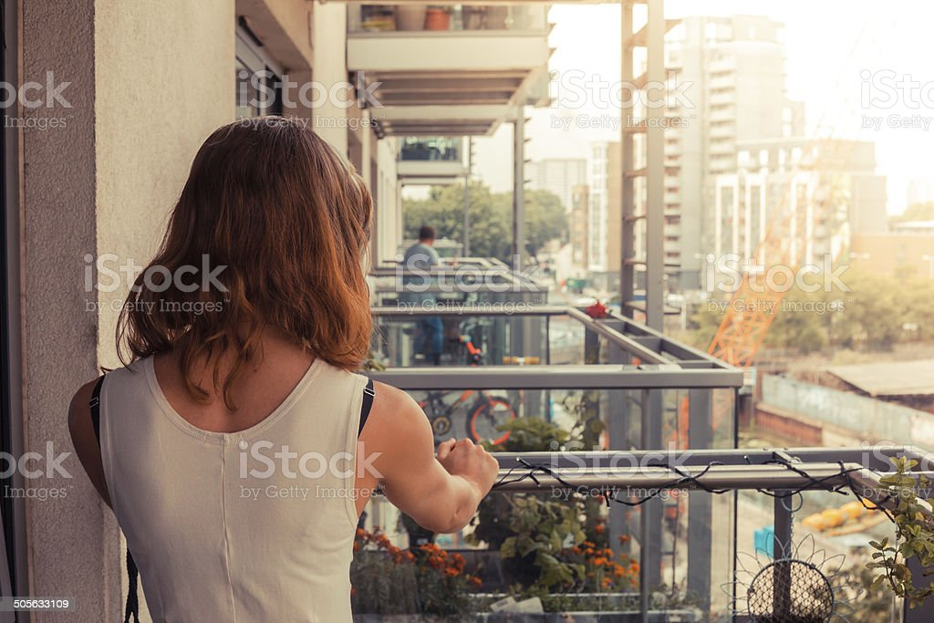 Young woman relaxing on her balcony stock photo