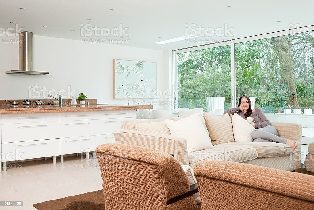 Young woman relaxing on sofa 免版稅 stock photo