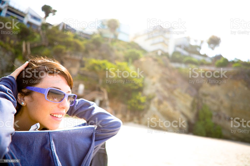 Young woman relaxing on the beach royalty-free stock photo