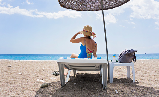 1071305850 istock photo Young woman relaxing on the beach 998496798