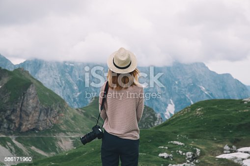 istock Young woman relaxing outdoor. Travel lifestyle 586171960