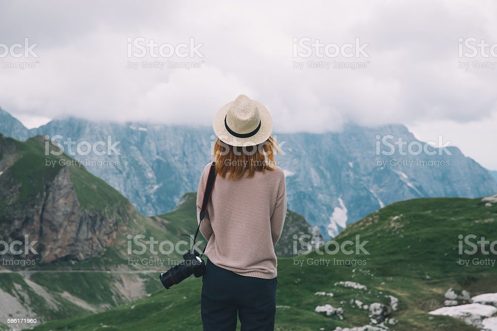 Young woman relaxing outdoor. Travel lifestyle stock photo