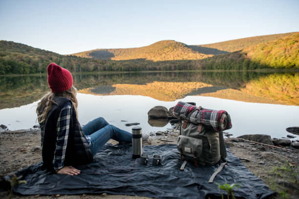 Young woman relaxing while camping stock photo