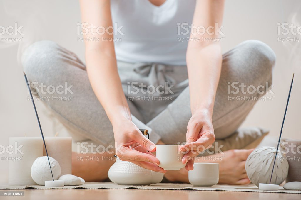 Young woman relaxing with tea and aromatherapy stock photo
