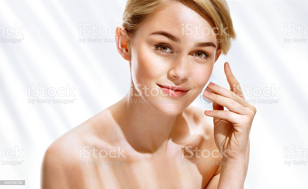 Young woman removing make up from her face stock photo