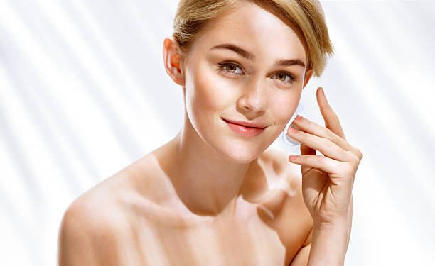 Young woman removing make up from her face ストックフォト