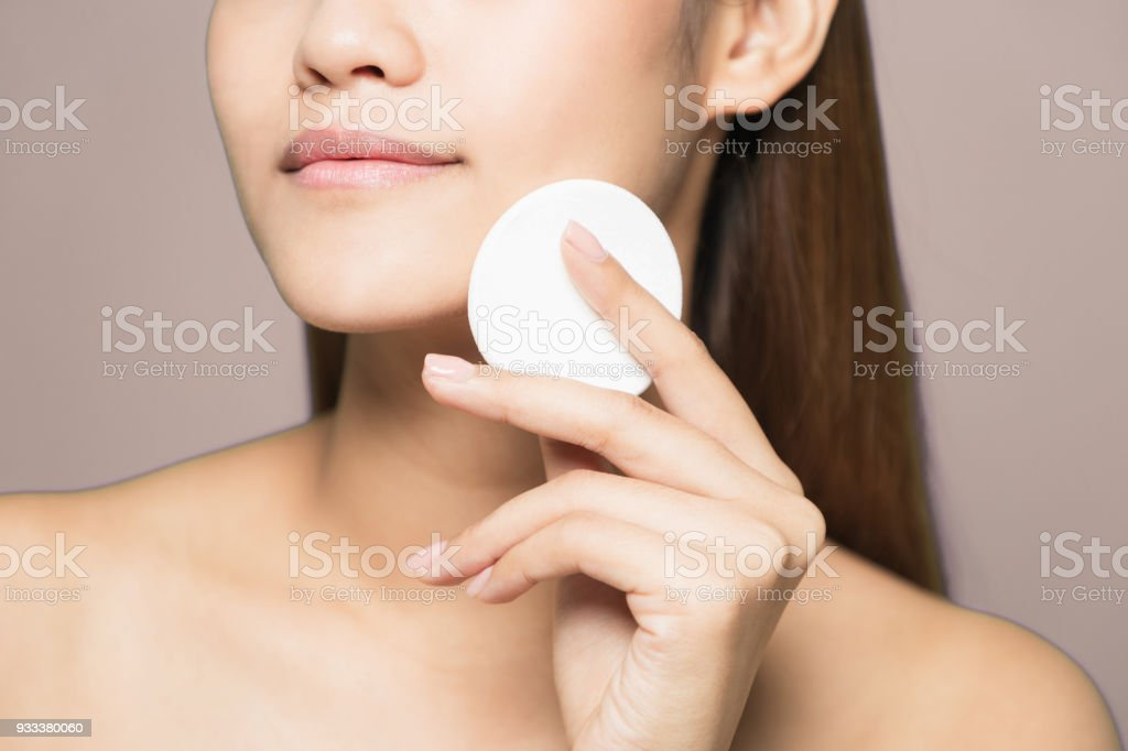 Young woman removing makeup. Skin care concept. stock photo