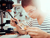 Young woman repairing and assembling pc computer