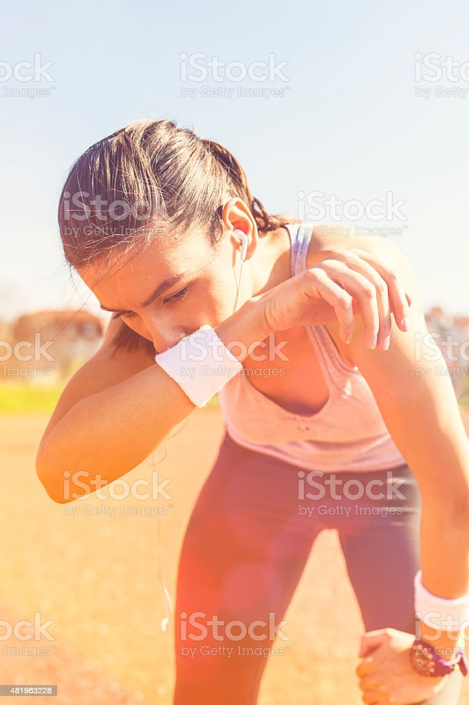 Young woman resting after runing. stock photo