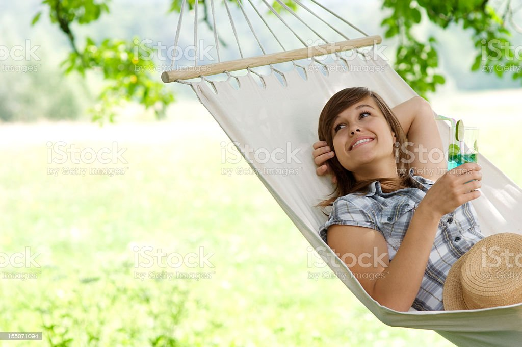Young woman resting on hammock stock photo