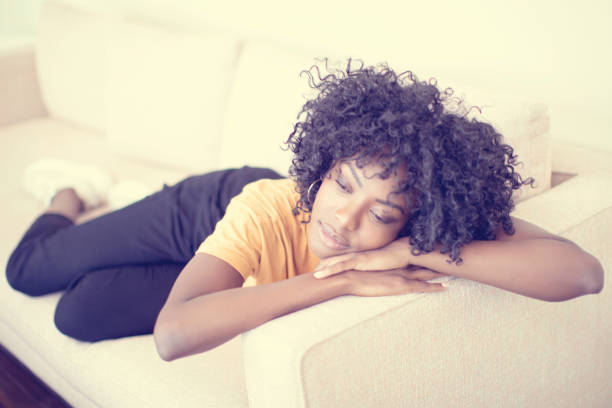 Young woman resting on the sofa stock photo
