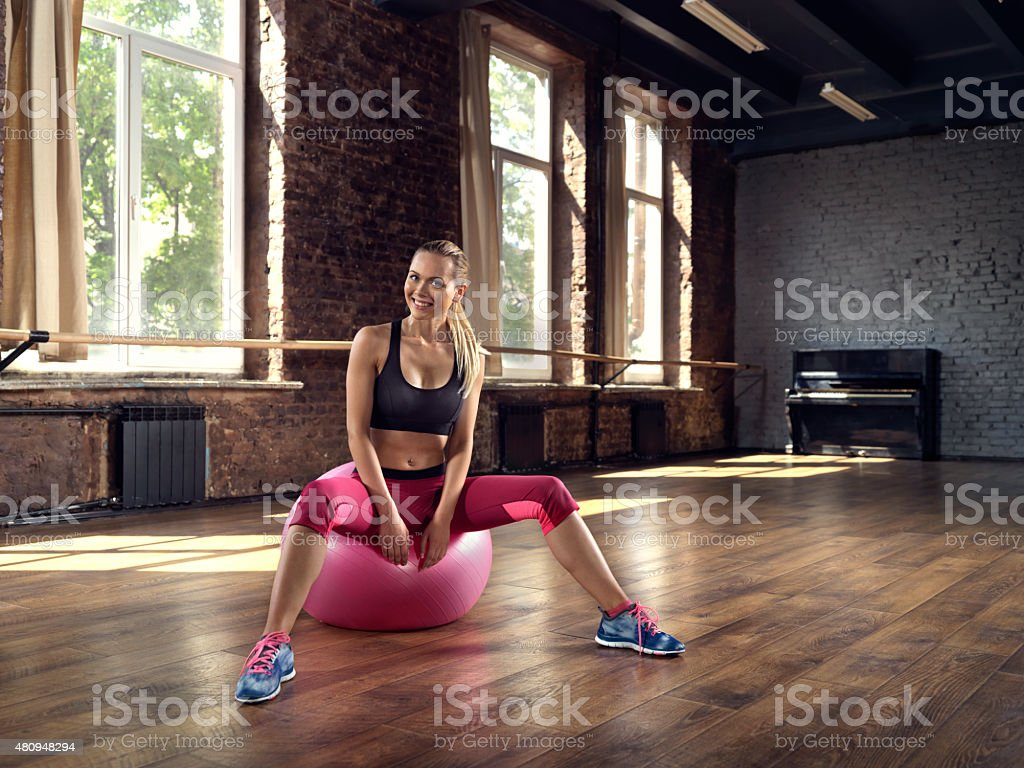 Young woman rests after fitness training stock photo