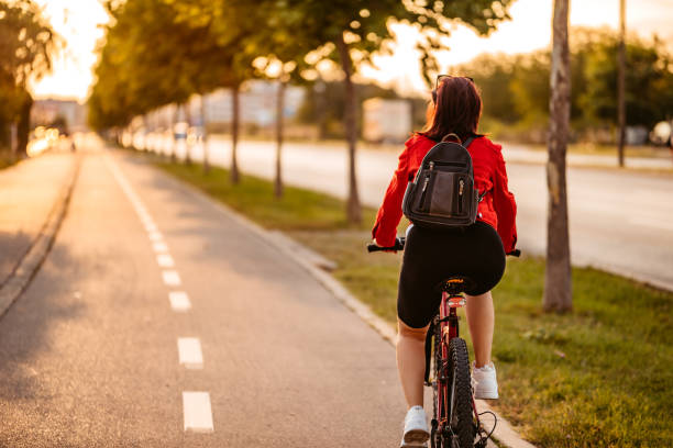 Young woman riding a bicycle stock photo