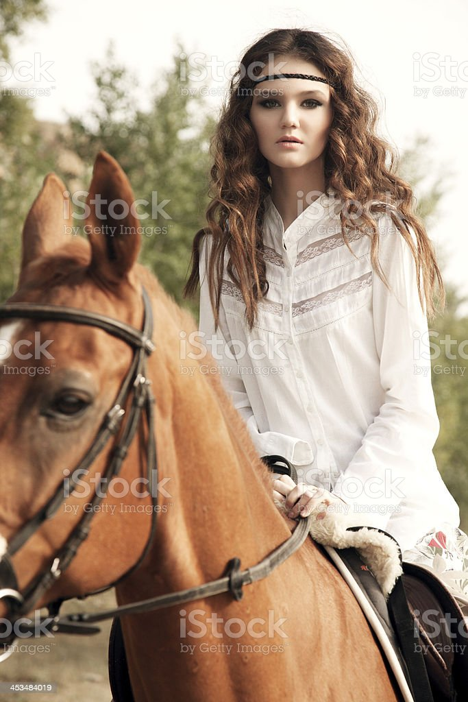 young woman riding a horse royalty-free stock photo