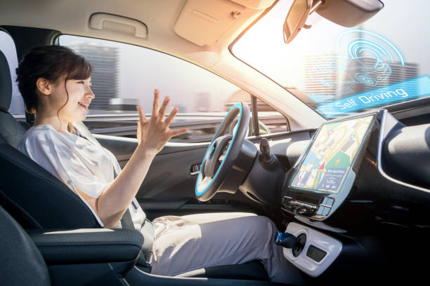 young woman riding autonomous car. self driving vehicle. autopilot. automotive technology. - dashboard vehicle part stock photos and pictures