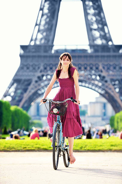 Young Woman Riding Bike Bicycle at Eiffel Tower stock photo