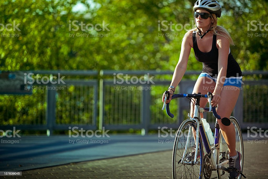 Young Woman Riding Her Bicycle stock photo