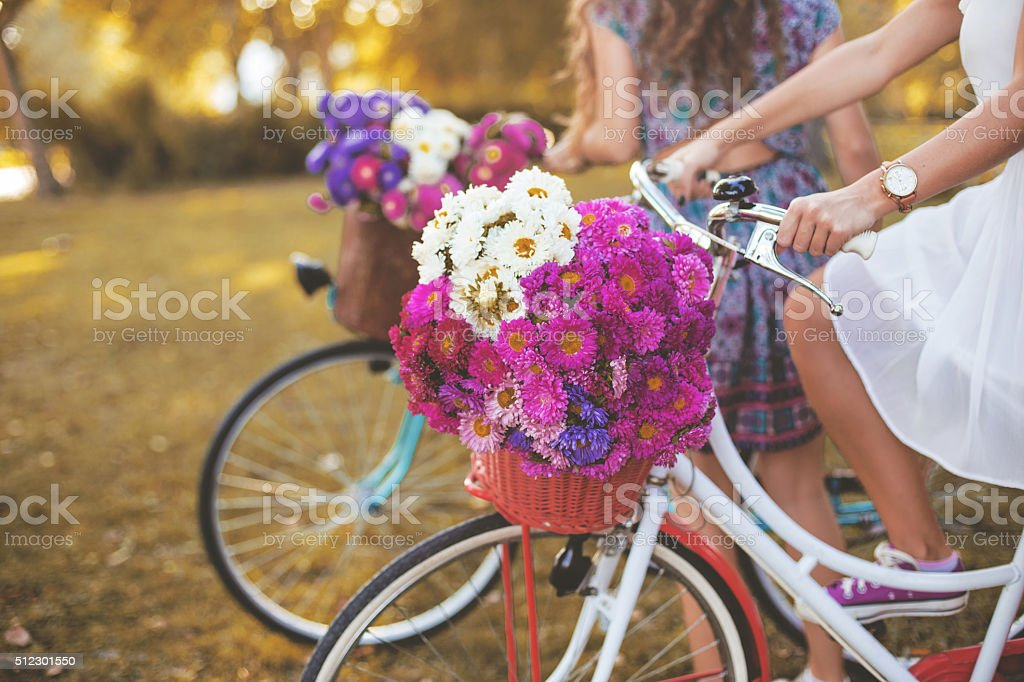 Young woman riding her white retro hipster bike stock photo
