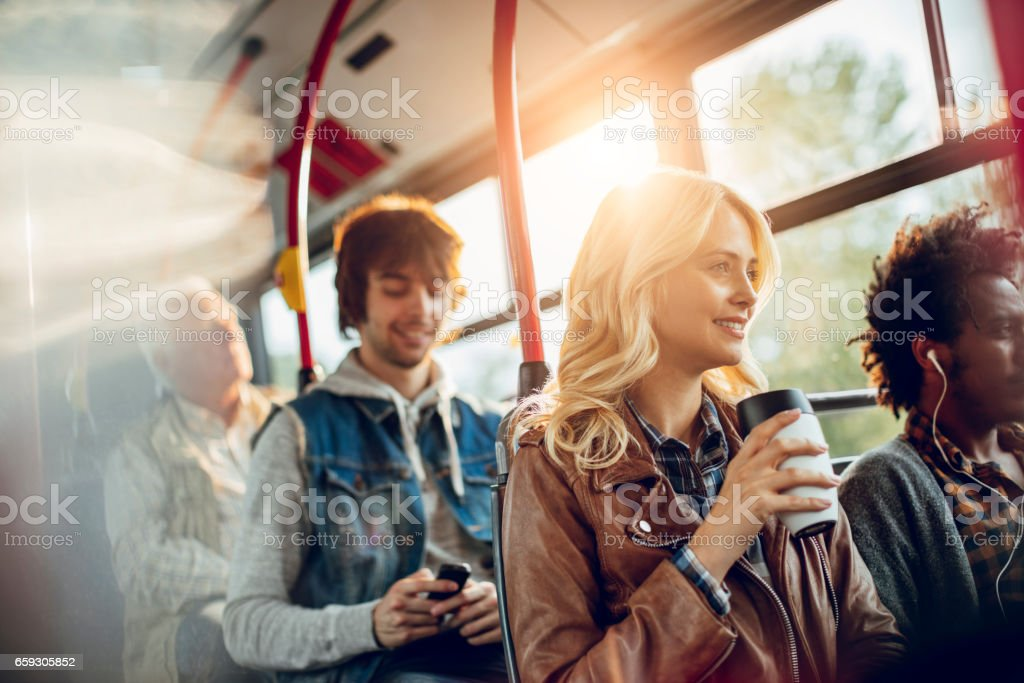 Young woman riding in a bus stock photo