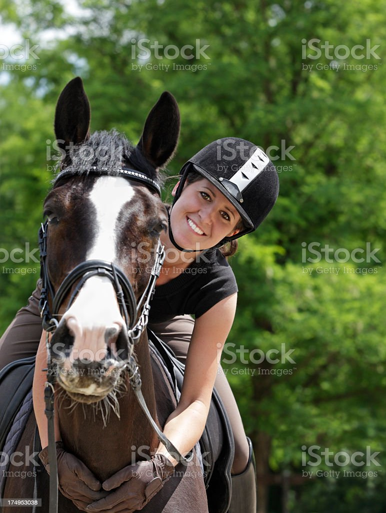 Young woman riding in her horse stock photo