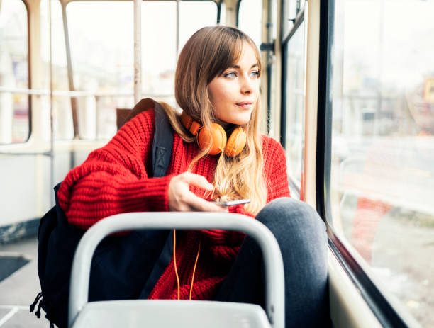 Young woman riding in public transportation stock photo