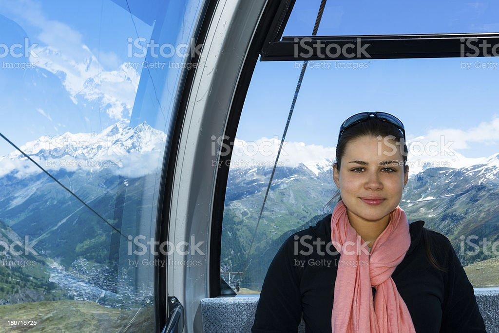 Young woman riding on a gondola (cable car) -XXXL royalty-free stock photo
