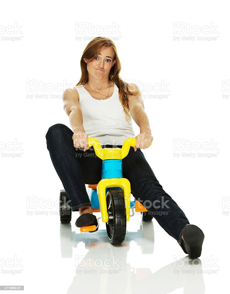 Young woman riding on a tricycle royalty-free stock photo
