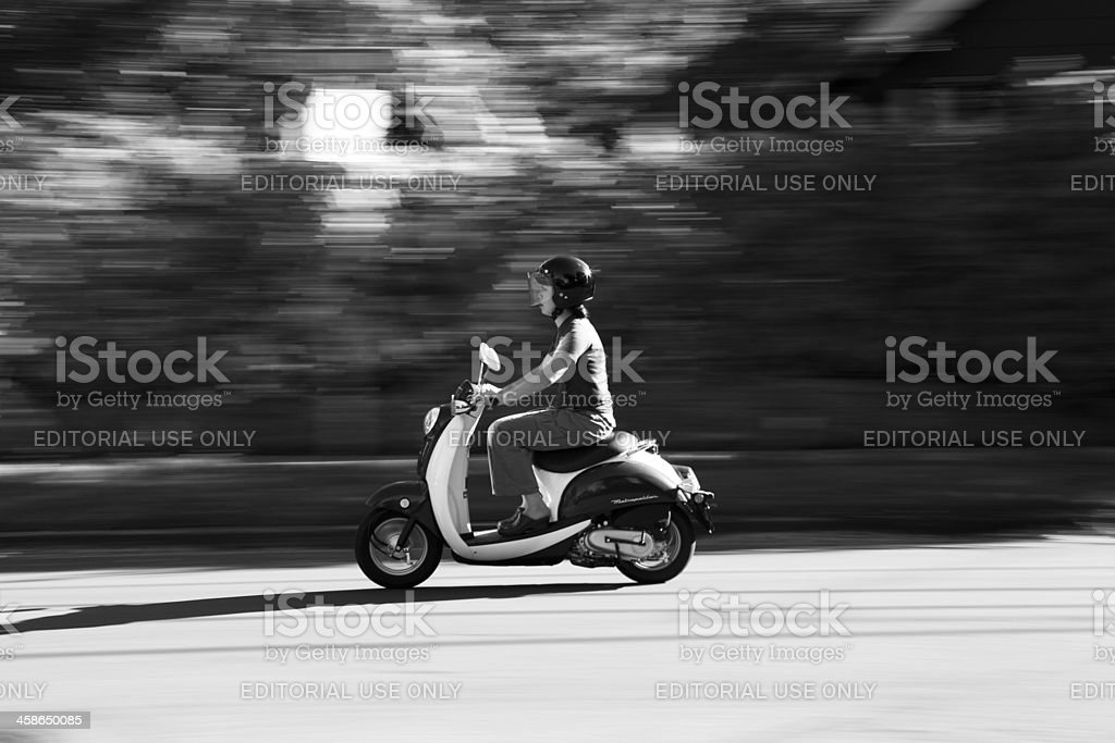 Young woman riding scooter in Portland Oregon stock photo