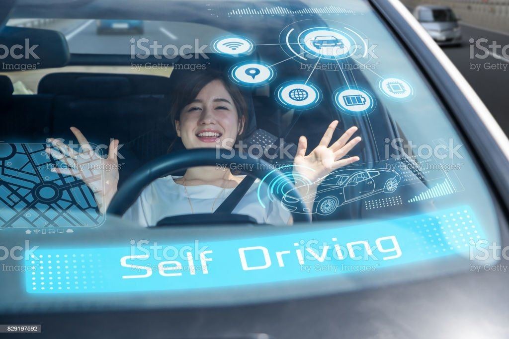 young woman riding the self driving car. autonomous car. stock photo