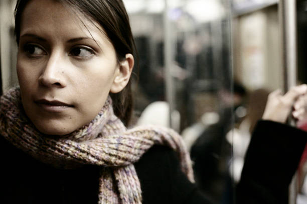 Young woman riding the subway back home woman riding the subway, desaturated image desaturated stock pictures, royalty-free photos & images