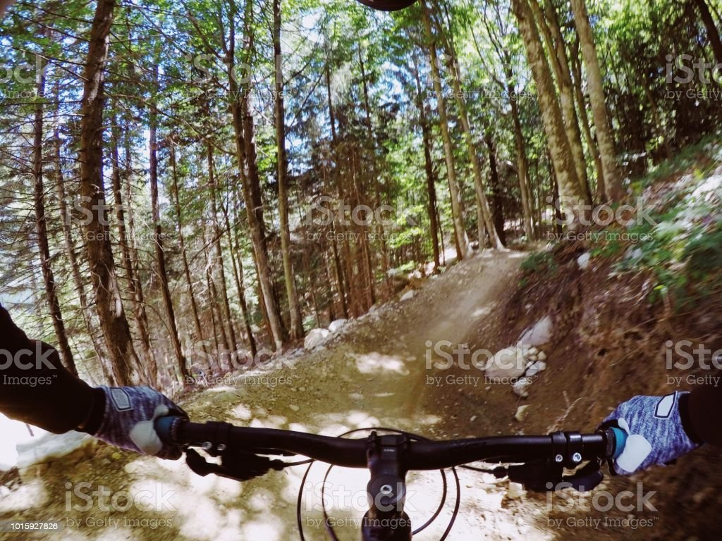 Young Woman Riding Trails In Italy Molveno Mountain Bike
