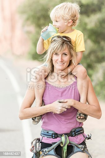 istock Young Woman Rock Climber and Toddler Son 168482437