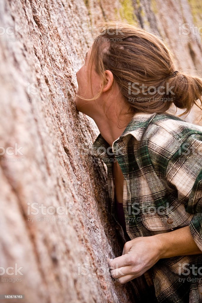 Young Woman Rock Climbing royalty-free stock photo