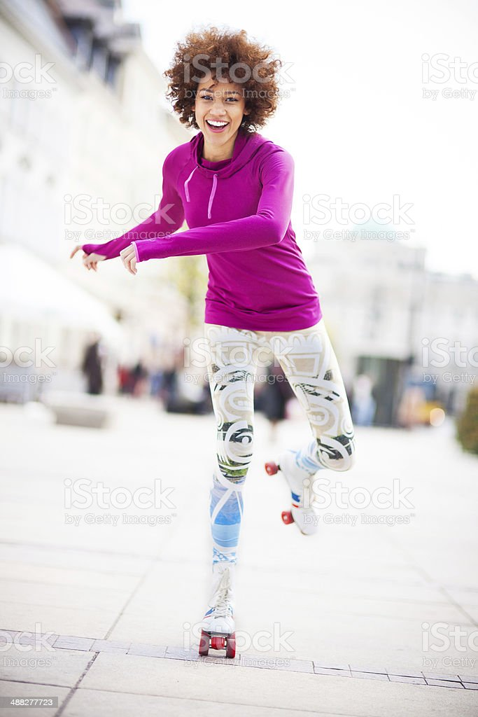 Young woman roller-skating stock photo