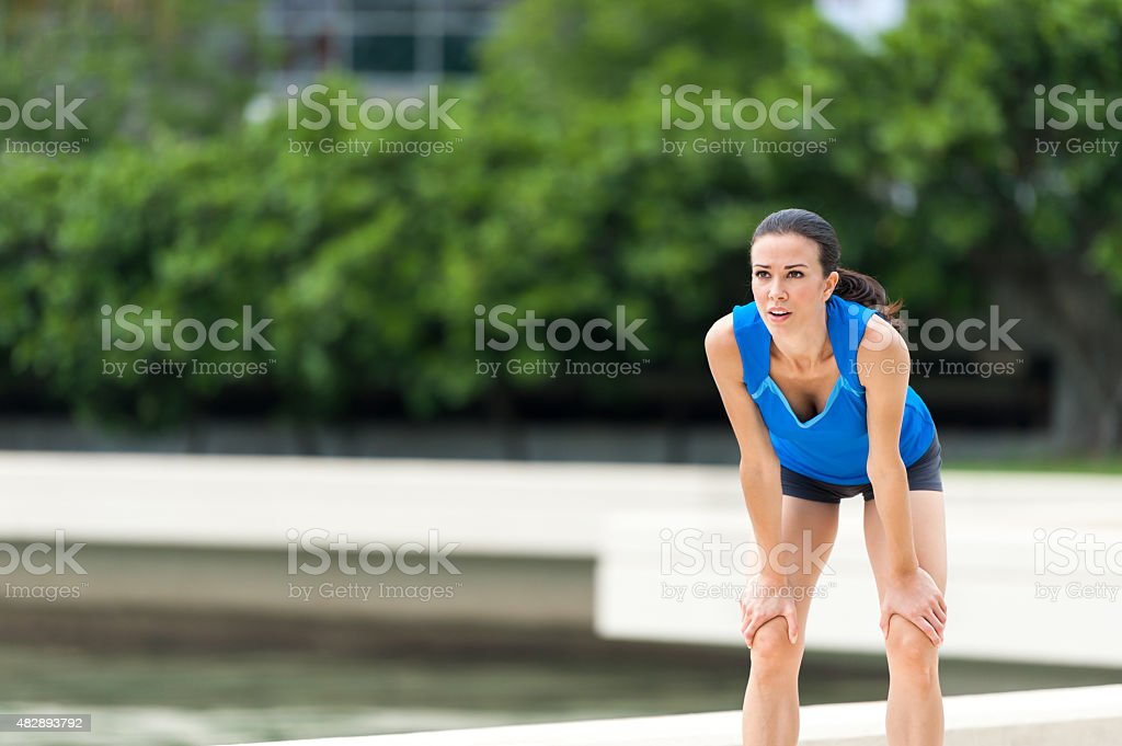Young Woman Runner jogger resting stock photo