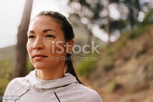 istock Young woman runner looking away 675691930