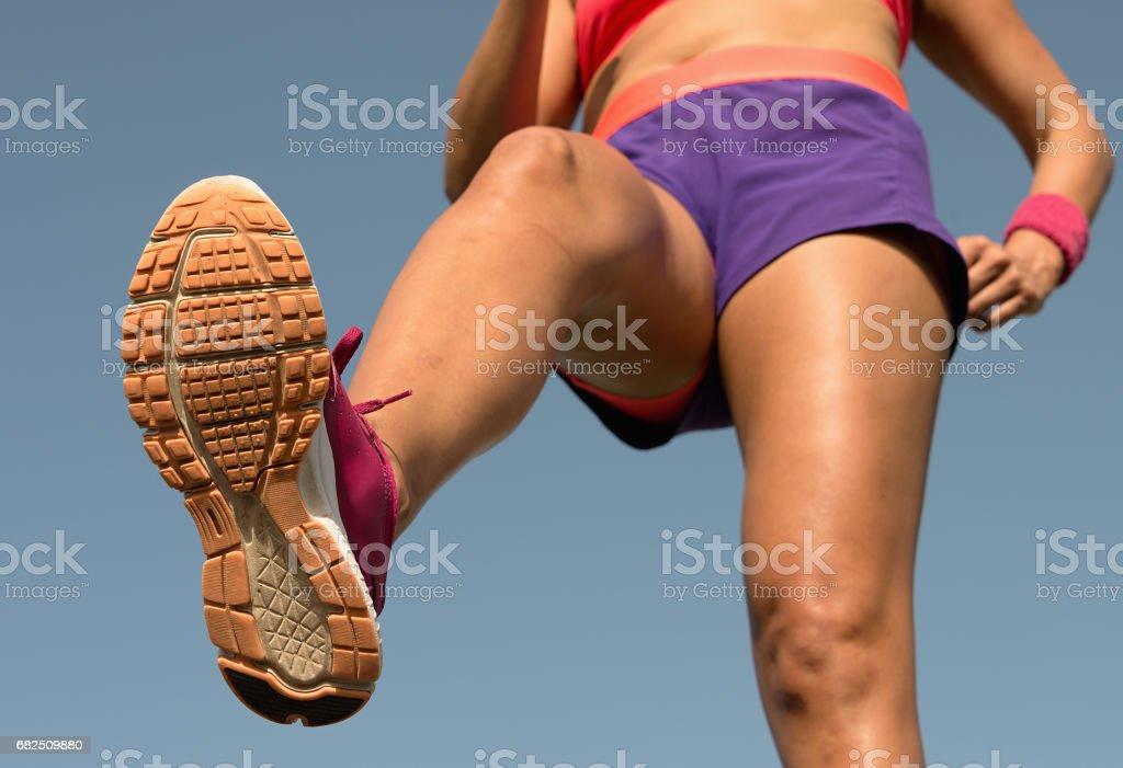Young woman runner running,training for marathon run. royalty-free stock photo