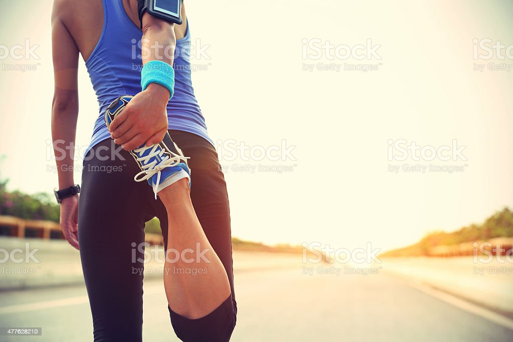 young woman runner warm up outdoor stock photo
