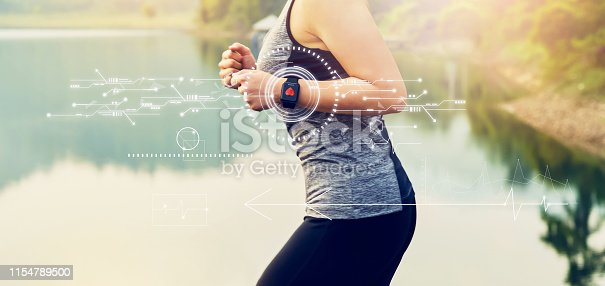 istock Young woman running and technology healthcare wellness with the screen icon innovation and sports watch, performance of body. 1154789500