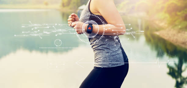 Young woman running and technology healthcare wellness with the screen icon innovation and sports watch, performance of body. Young woman running and technology healthcare wellness with the screen icon innovation and sports watch, performance of body. women's track stock pictures, royalty-free photos & images
